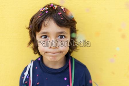 little boy pulling funny face in