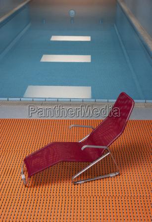 deckchair at indoor swimming pool