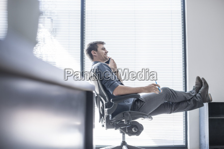 businessman in office on the phone