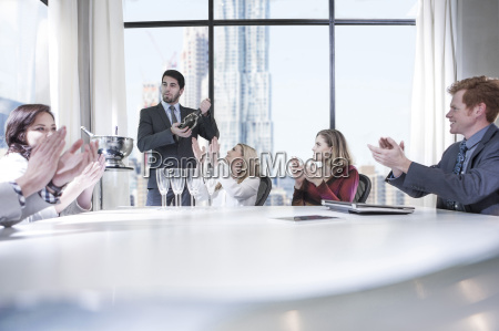 business people celebrating success in office
