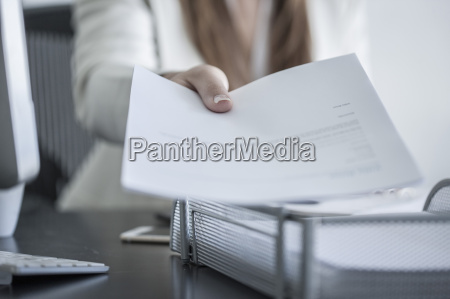 close up of woman at desk
