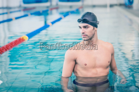handsome man wearing swim cap and