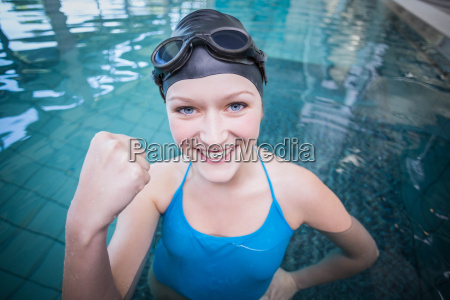 fit woman wearing swim cap and