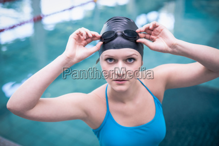 pretty woman wearing swim cap and