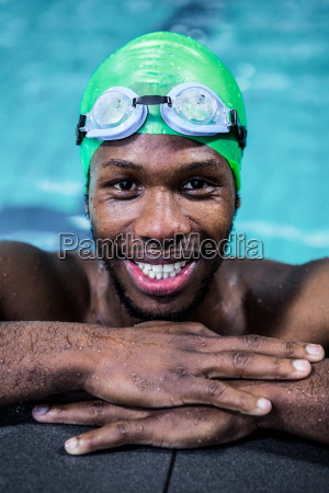 smiling fit man in the swimming