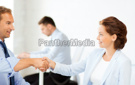 man and woman shaking hands in