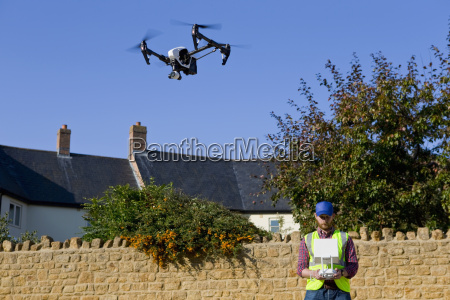 surveyor operating surveillance drone in blue