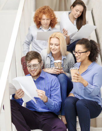 team with papers and take away