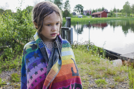 portrait of girl standing on lakefront