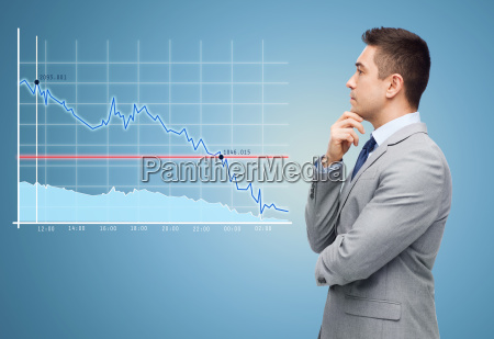thinking businessman in suit making decision