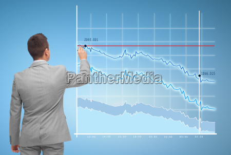 businessman drawing virtual chart
