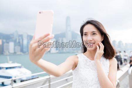 woman using mobile phone for taking