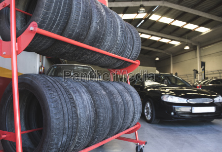 tires in workshop and mechanic driving