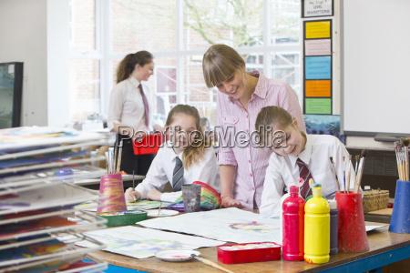 art teacher teaching middle school students