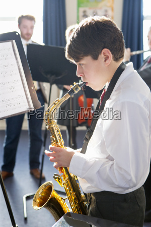 middle school student playing saxophone at