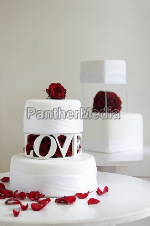 two wedding cakes with decorated with