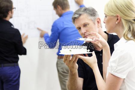 mature man and young woman constructing
