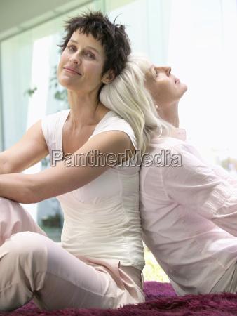 middle aged female couple sitting back