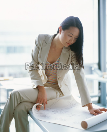 businesswoman looking at plans