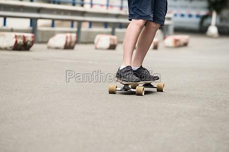 boy skating on street