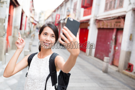 woman taking selfie by cellphone