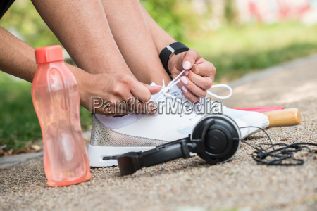 female athlete tying shoelaces