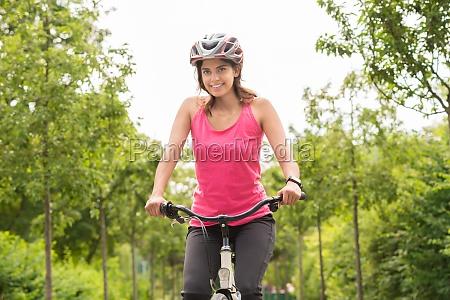 young woman enjoying ride on bicycle