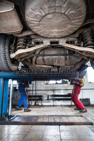 inside a garage two mechanics
