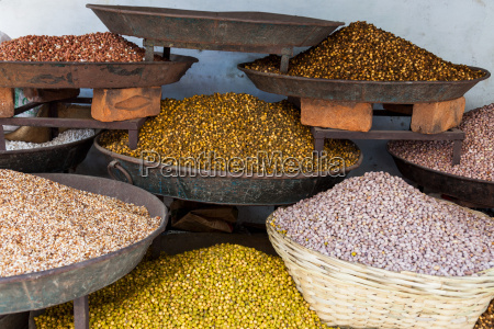 dishes of spices for sale in