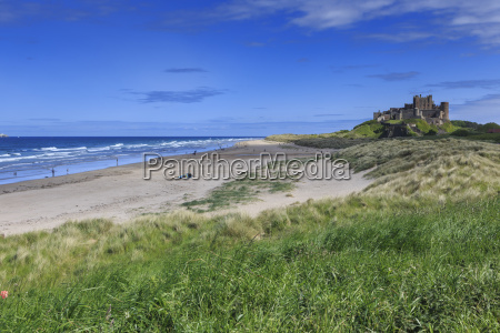 bamburgh castle across the dunes early
