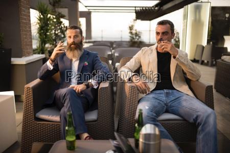 two men sitting side by side