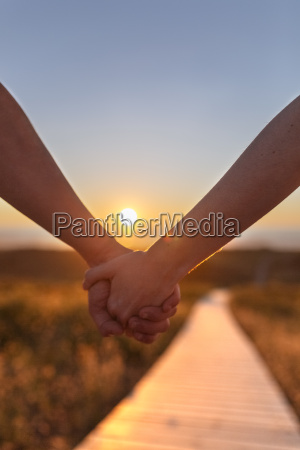 young couple holding hands close up