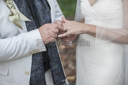 hands of bride and groom with