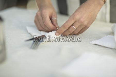 close up of waitress preparing dining