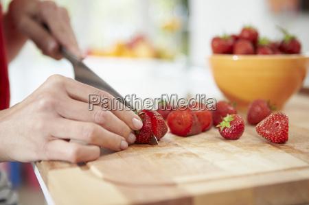 close up of woman preparing fruit