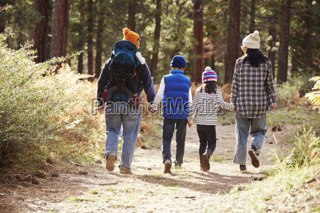 parents and three children walking in