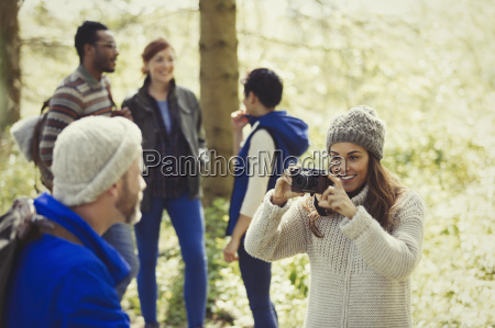 woman photographing man hiking with camera