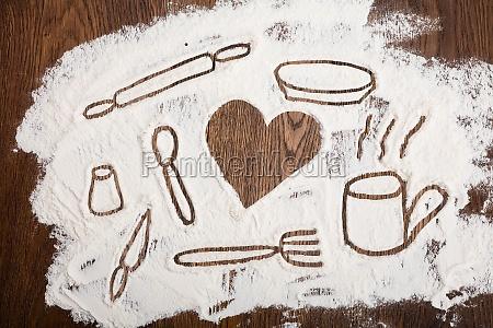 kitchen utensil drawn on flour