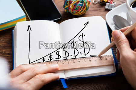 person hand drawing dollar growth chart