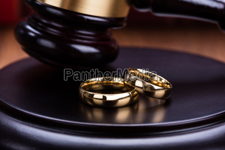 wedding rings are placed on gavel