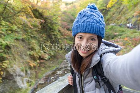 woman holding digital camera to take