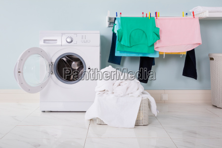 washing machine with pile of cloth