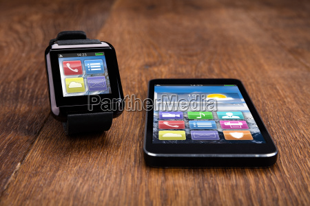 mobile phone with smart watch on