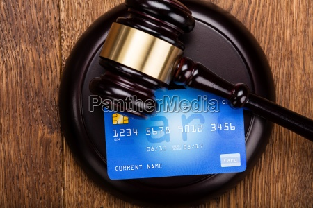 credit card on wooden gavel