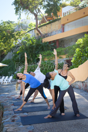 yoga instructor teaching a group