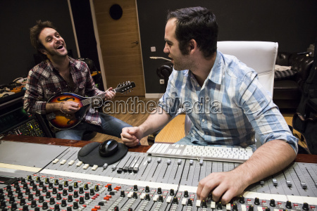 guitar player and audio engineer in