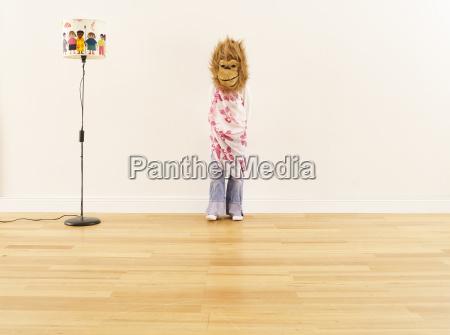 girl wearing monkey mask