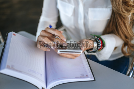 close up of womans hands using