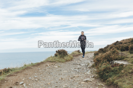 ireland howth woman running on coastal