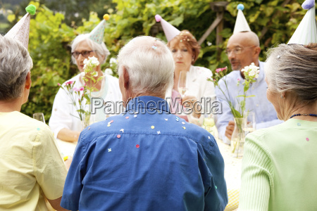 seniors celebrating birthday oarty in garden